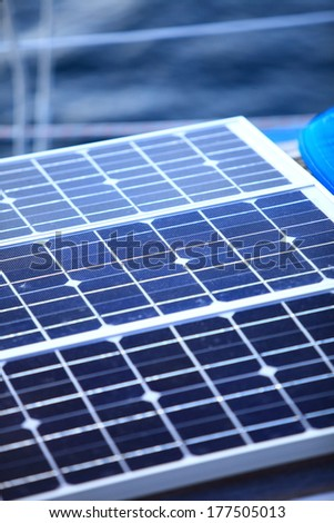 Solar charging batteries aboard a sail boat. Photovoltaic panels renewable eco energy concept - stock photo