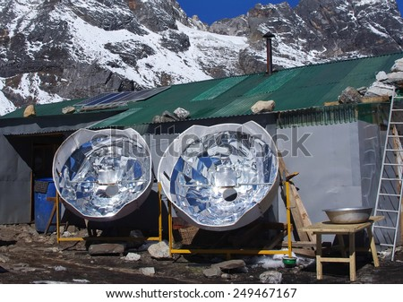 Solar cooker in the Himalaya mountains. Nepal - stock photo