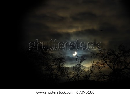 Solar eclipse at winter looks like scaring night scene from the nightmare - stock photo