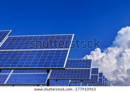 solar energy panel alternative energy on blue sky background  - stock photo