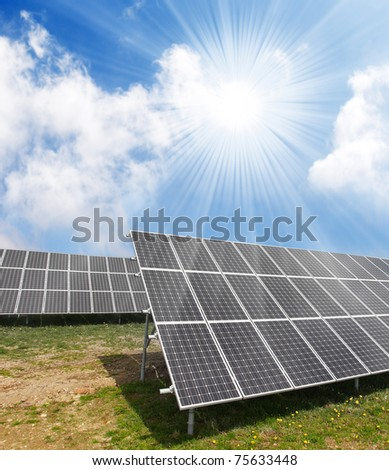 Solar energy panels against sunny sky. - stock photo