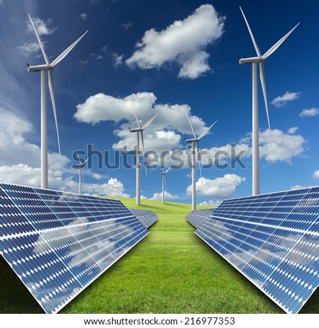 solar energy panels and wind turbine against blue sky  - stock photo