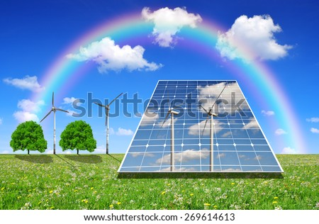 Solar energy panels and wind turbines on meadow. Green energy concept. - stock photo