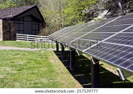 Solar Energy Panels Behind Building  - stock photo