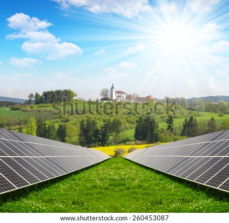 Solar energy panels in spring landscape. Green energy. - stock photo
