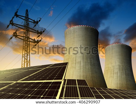 Solar energy panels, nuclear power plant and electricity pylon at sunset - stock photo