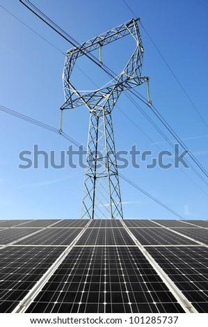 Solar energy panels with power line - stock photo
