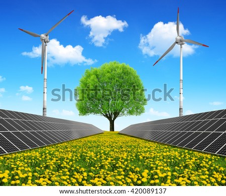 Solar energy panels with wind turbines and tree on dandelion field. Clean energy. - stock photo