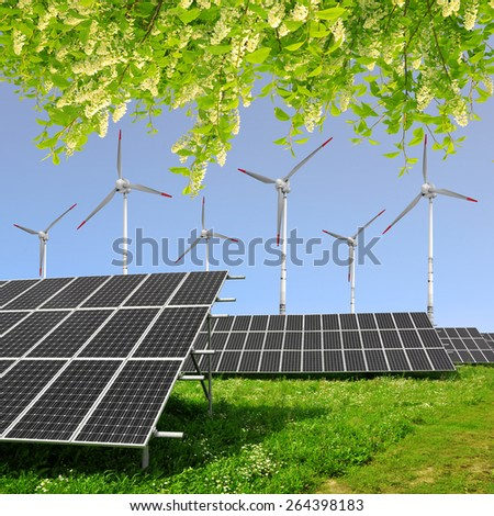 Solar energy panels with wind turbines. Green energy concept. - stock photo