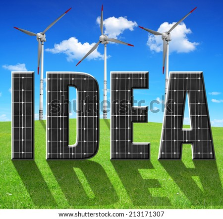 Solar energy panels with wind turbines on meadow.Green energy concept. - stock photo