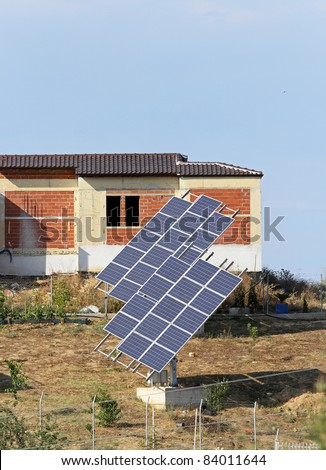 Solar energy power system and new homes - stock photo