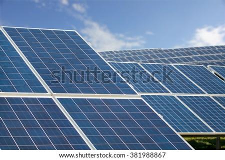 Solar Farm Park. Solar Panels Sunny Blue Sky, Sustainable Energy. - stock photo