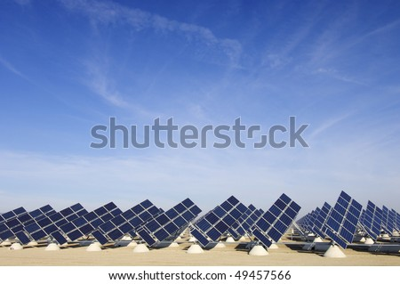 solar field with blue sky - stock photo