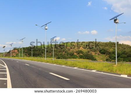 Solar modules panel on electric pole, use of Solar energy for lightning of highway, Rio de Janeiro, Brazil - stock photo