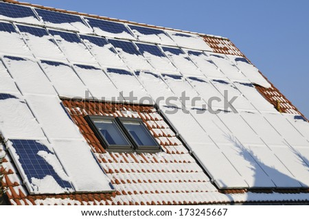 Solar modules with snow in winter - stock photo