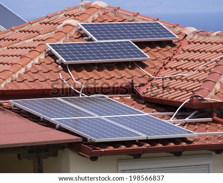 Solar panel array on a rooftop - stock photo