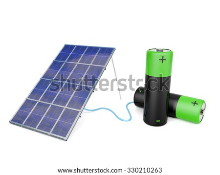 Solar panel attached to two AA batteries - stock photo