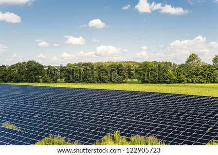 Solar Panel field in Bavaria Germany with blue sky and clouds - stock photo