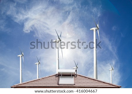 Solar panel for hot water system on roof  and wind turbines  blue sky background , Energy saving concept - stock photo