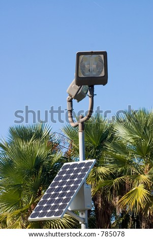 Solar panel generating clean electricity to run street light when night comes. - stock photo