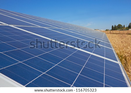 Solar Panel in a field of wheat - stock photo