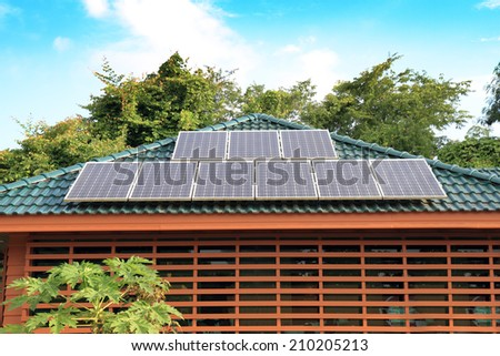 Solar panel on a green roof - stock photo