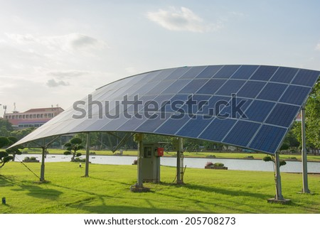 Solar panel produces green,  energy from the sun. - stock photo