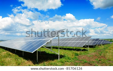 Solar panel produces green, enviromentally friendly energy from the sun. - stock photo