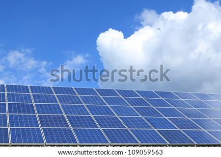 Solar panel produces green, environmentally friendly energy from the sun. - stock photo
