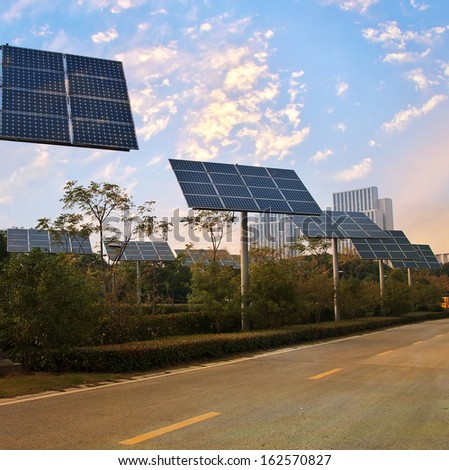 Solar panel produces green, environmentally friendly energy from the sun. - stock photo