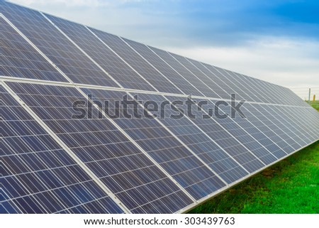 Solar panel produces green, environmentally friendly energy from the sun, focus foreground - stock photo