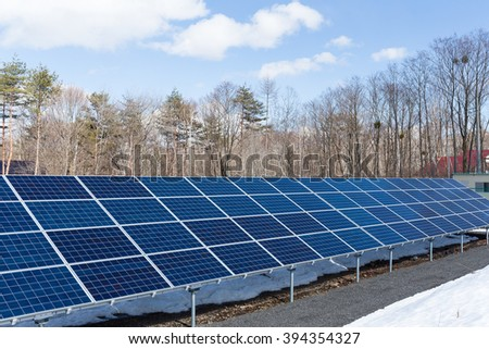 Solar panel station in countryside - stock photo