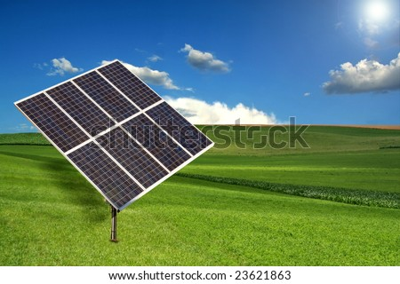 Solar Panel Sun Tracking System in a Meadow - stock photo