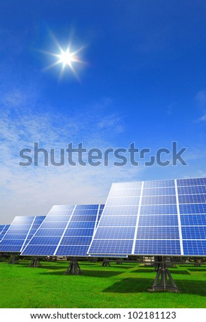 Solar panel system ,blue sky and sunshine with green grass - stock photo