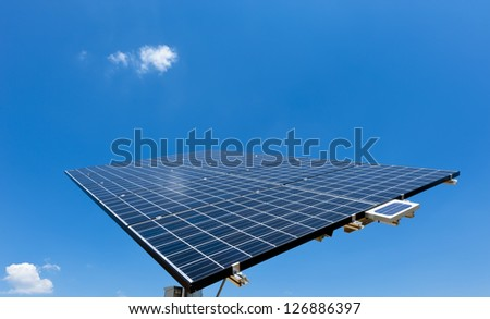 Solar Panel with blue Sky and some small clouds - stock photo