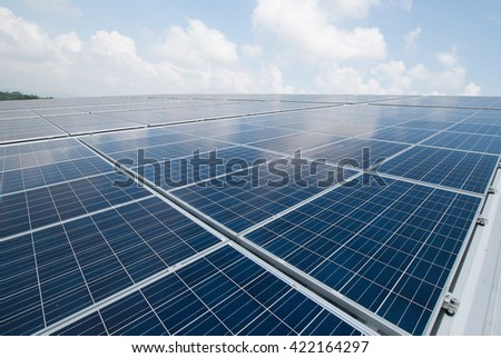 Solar Panels Against The Deep Blue Sky And Clouds. copy space - stock photo