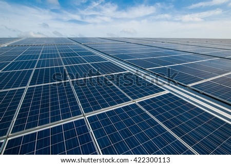 Solar Panels Against The Deep Blue Sky. copy space for text - stock photo