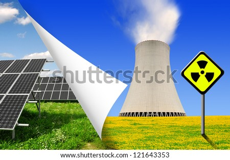 Solar panels and nuclear power plant - stock photo