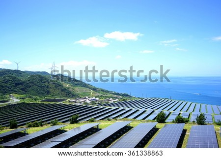 Solar panels and wind generators in Large Photovoltaic power station (solar park) / Renewable energy Sustainable energy / Solar Power Plant - stock photo