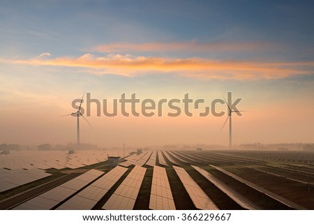 Solar panels and windmills in the power plant - stock photo