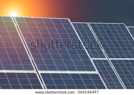 Solar Panels at sunset - stock photo