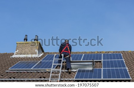 solar panels construction on the roof - stock photo