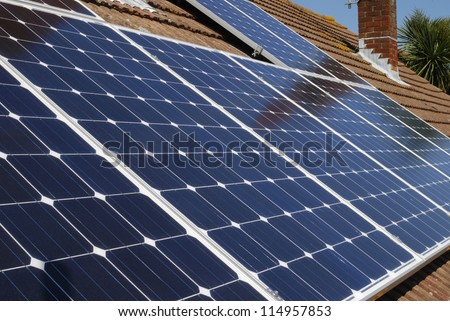 Solar panels for electricity generation on domestic house roof in Sussex. England - stock photo