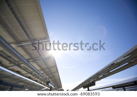 Solar Panels from underneath, sun flare - stock photo
