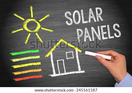 Solar Panels - House with Energy Efficiency - stock photo