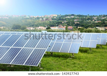 Solar Panels in a field of Grass - stock photo