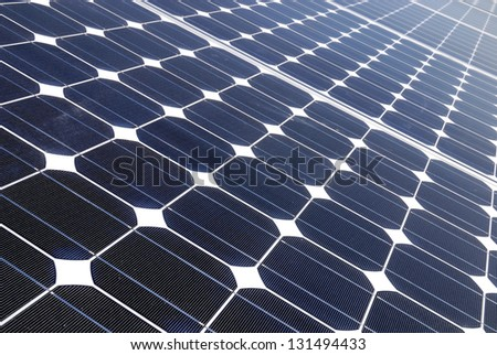 Solar panels in a photovoltaic power plant - stock photo