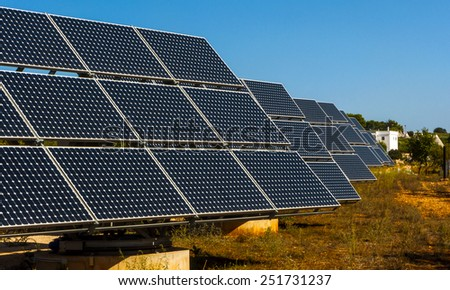 Solar panels in the landscape of the trulli of Alberobello. Green energy concept - stock photo