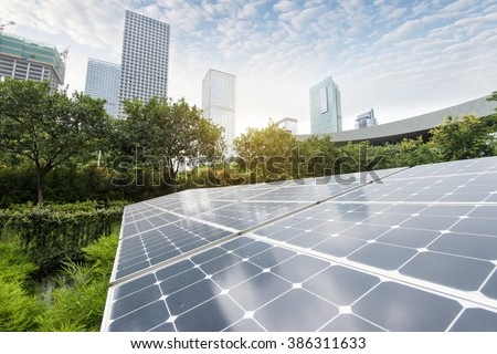 Solar Panels In The Park Of Modern City - stock photo