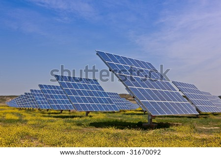 Solar panels in the power plant for renewable energy - stock photo